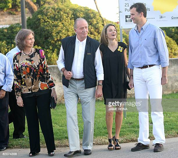Spain's Crown Prince Felipe and Princess Letizia pose as they arrive with King Juan Carlos and Queen Sofia at the trophy ceremony of a regatta on...