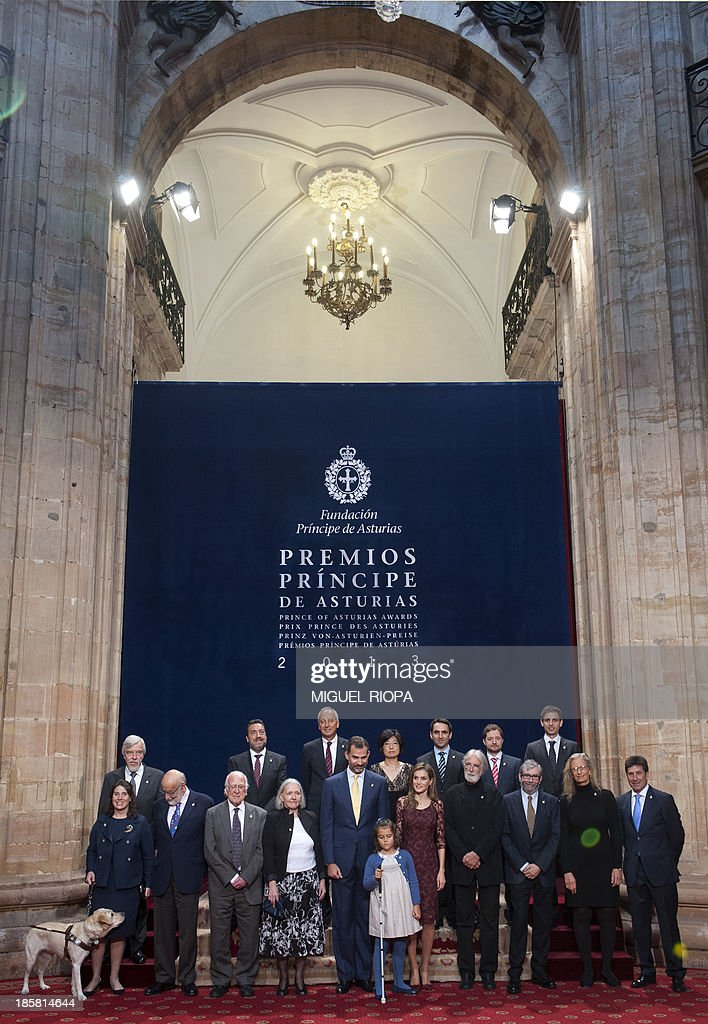 Spain's Crown Prince Felipe (C-L) and Princess Letizia (C-R) pose with the 2013 Prince of Asturias Award laureates, (L-R) Spanish golfer Jose Maria Olazabal, US photographer Annie Leibovitz, Spanish writer Antonio Munoz Molina, Austrian director Michael Haneke, Dutch-American sociologist Saskia Sassen, British scientist Peter Higgs, Belgian scientist Francois Englert and German scientist Rolf Heuer, director general of CERN (top L) at the Reconquista Hotel of the northern Spanish city of Oviedo on October 25, 2013.