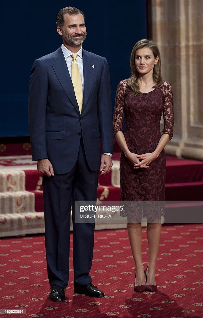 Spain's Crown Prince Felipe (L) and Princess Letizia wait for the 2013 Prince of Asturias Award laureates at the Reconquista Hotel of the northern Spanish city of Oviedo on October 25, 2013.
