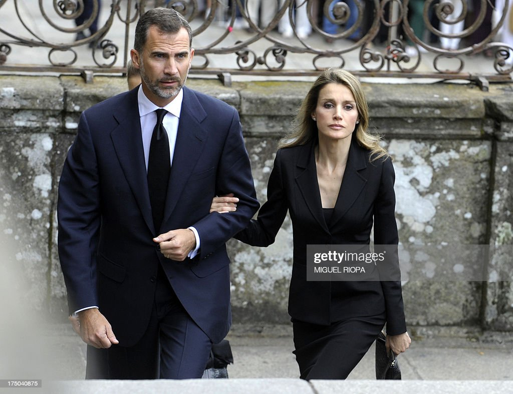 Spain's Crown Prince Felipe (L) and Spain's Princess Letizia arrive to attend a memorial service for the victims the derailed train of Angrois, at the cathedral of Santiago de Compostela on July 29, 2013. The driver of a train that hurtled off the rails in Spain was charged on July 28 with 79 counts of reckless homicide and released on bail after being questioned by a judge.