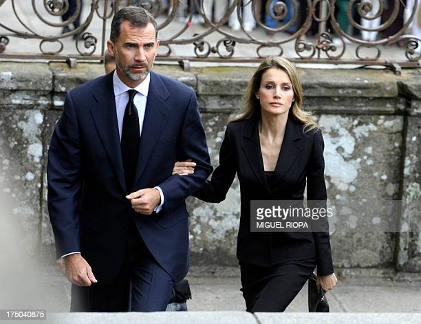 Spain's Crown Prince Felipe and Spain's Princess Letizia arrive to attend a memorial service for the victims the derailed train of Angrois at the...
