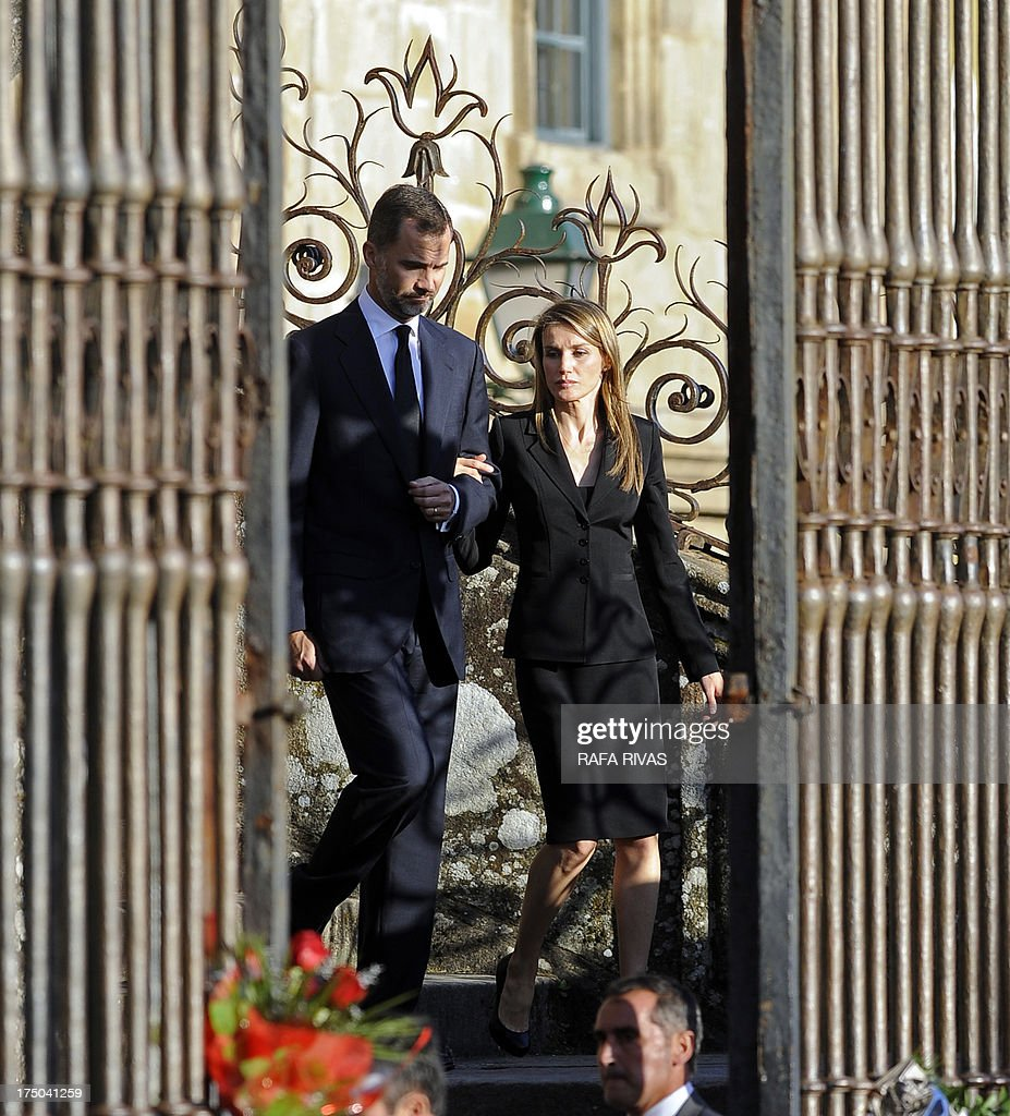 Spain's Crown Prince Felipe (L) and Spain's Princess Letizia leave a memorial service for the victims the derailed train of Angrois, at the cathedral of Santiago de Compostela on July 29, 2013. The driver of a train that hurtled off the rails in Spain was charged on July 28 with 79 counts of reckless homicide and released on bail after being questioned by a judge.