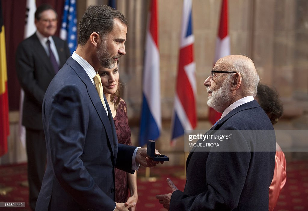 Spain's Crown Prince Felipe (L) gives a medal to Belgian scientist Francois Englert, one of the laureates of the 2013 Prince of Asturias Award for Technical and Scientific Research, during an official audience at the Reconquista Hotel of the northern Spanish city of Oviedo on October 25, 2013.