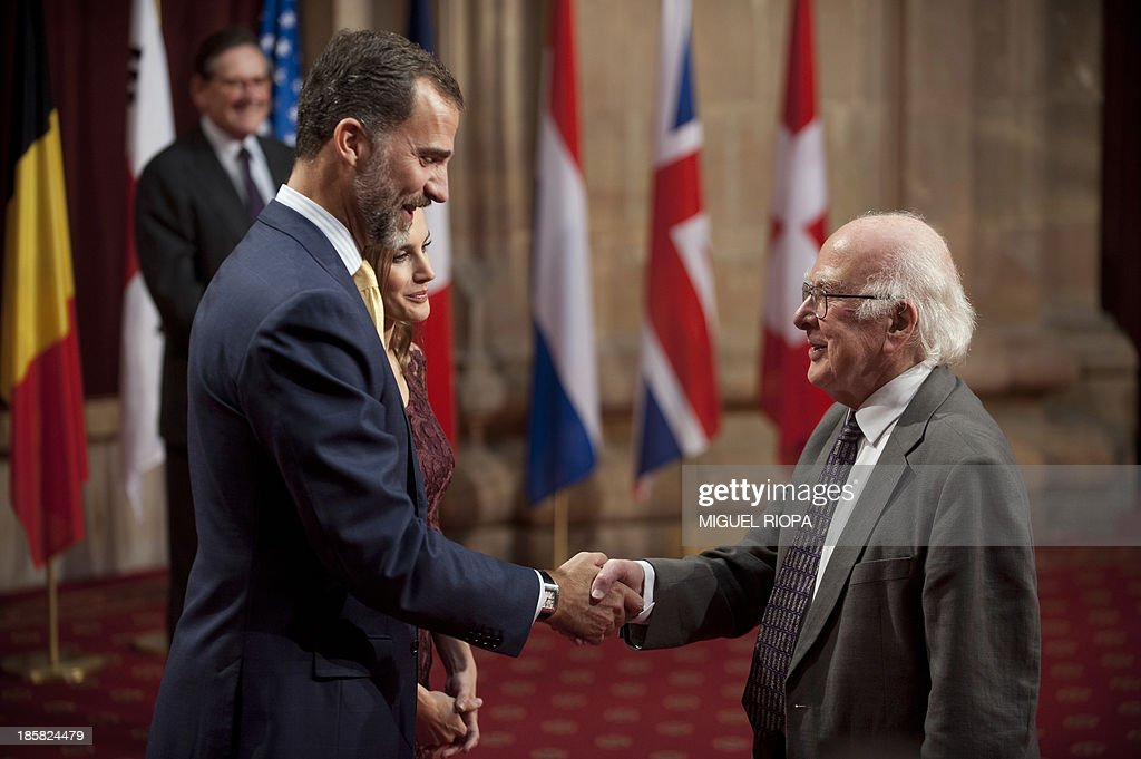 Spain's Crown Prince Felipe (L) shakes hands with British scientist Peter Higgs, one of the laureates of the 2013 Prince of Asturias Award for Technical and Scientific Research, during an official audience at the Reconquista Hotel of the northern Spanish city of Oviedo on October 25, 2013.