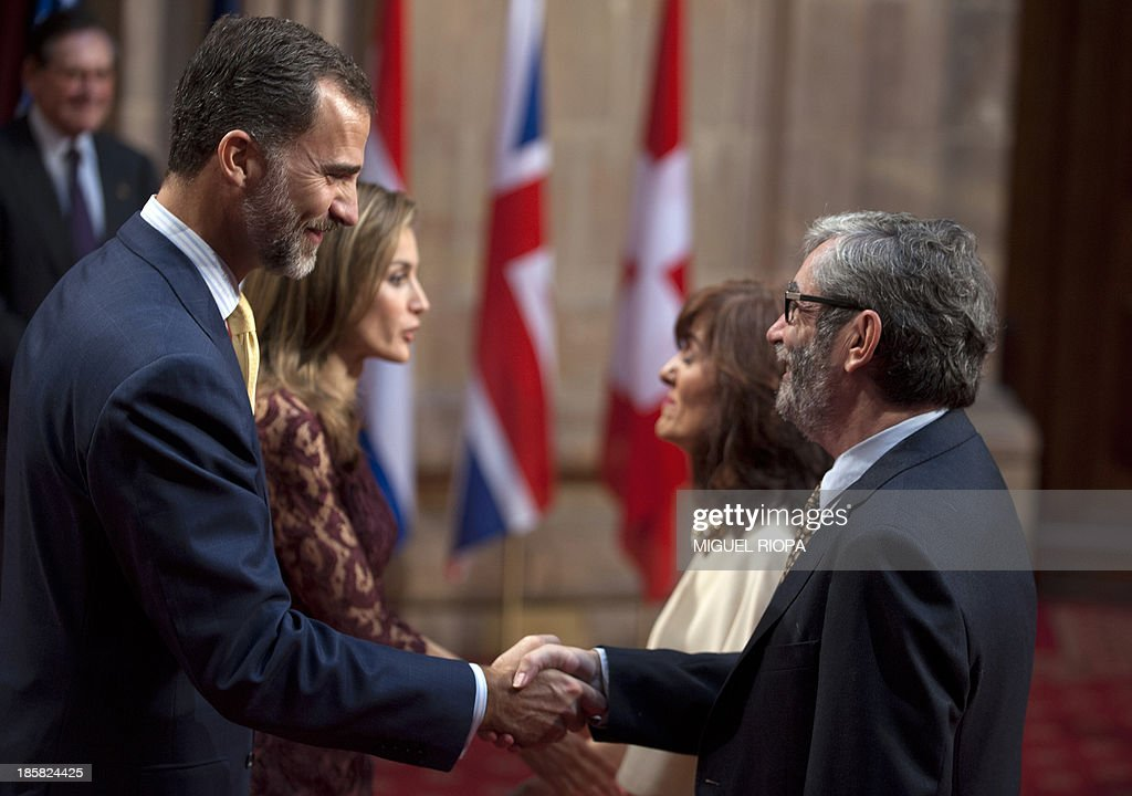 Spain's Crown Prince Felipe (L) shakes hands with Spanish writer Antonio Munoz Molina, the laureate of the 2013 Prince of Asturias Award for Literature, during an official audience at the Reconquista Hotel of the northern Spanish city of Oviedo on October 25, 2013.