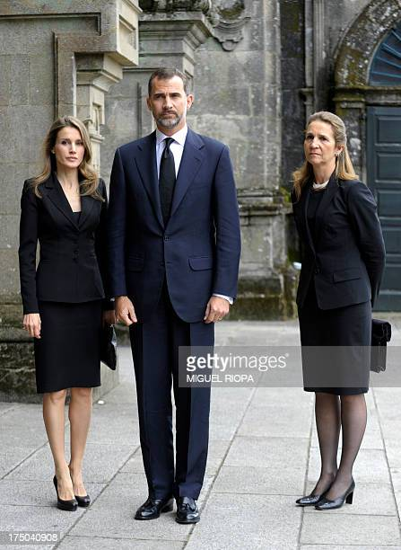 Spain's Crown Prince Felipe Spain's Princess Letizia and Spain's Infanta Elena pose as they arrive to attend a memorial service for the victims the...