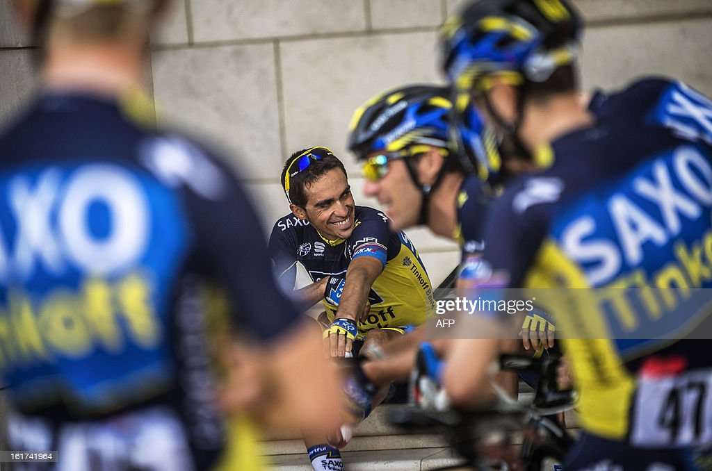 Spain's cyclist Alberto Contador of Saxo-Tinkoff team sits among teammates waiting for the start of the fifth stage of the cycling Tour of Oman on February 15, 2013, in the Omani capital Muscat. The fifth stage is a 144km ride from Al Alam Palace in Muscat to the Ministry of Housing in Boshar. AFP PHOTO / JEFF PACHOUD