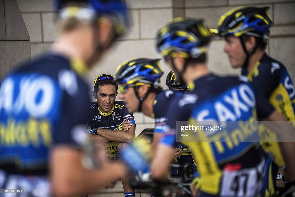 Spain's cyclist Alberto Contador of Saxo-Tinkoff team sits among teammates waiting for the start of the fifth stage of the cycling Tour of Oman on February 15, 2013, in the Omani capital Muscat. The fifth stage is a 144km ride from Al Alam Palace in Muscat to the Ministry of Housing in Boshar.