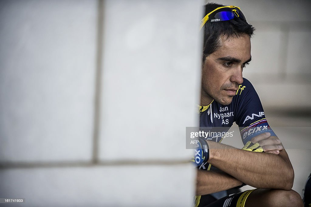 Spain's cyclist Alberto Contador of Saxo-Tinkoff team sits waiting for the start of the fifth stage of the cycling Tour of Oman on February 15, 2013, in the Omani capital Muscat. The fifth stage is a 144km ride from Al Alam Palace in Muscat to the Ministry of Housing in Boshar. AFP PHOTO / JEFF PACHOUD