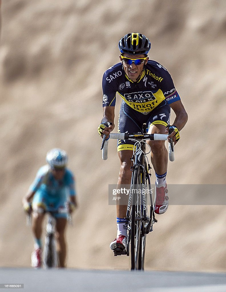Spain's cyclist Alberto Contador, of Team Saxo Tinkoff, arrives to cross the finish line at the end of the fourth stage of the Tour of Oman, on February 14, 2013, in Jabal al Akhdhar. The fourth stage was a 152.5km ride through the mountains from Al Satiyah to the finish line at the peak of a stiff climb at Jabal Al Akhdar. Contador finished fourth. AFP PHOTO / JEFF PACHOUD