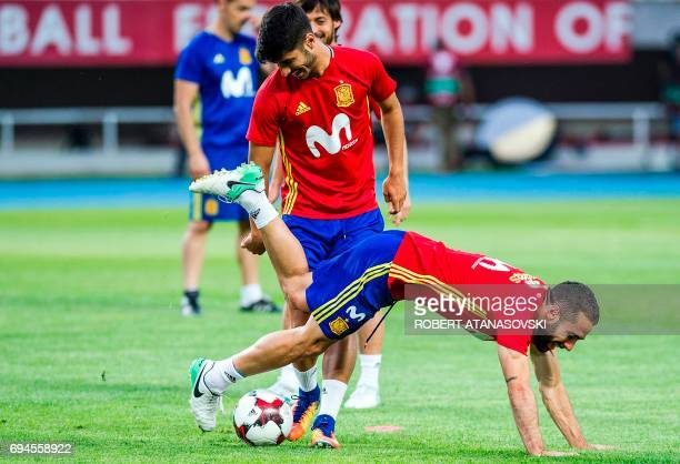 Spain's Dani Carvajal and Marco Asensio take part in a training session in Skopje on June 10 on the eve of the FIFA World Cup 2018 qualification...