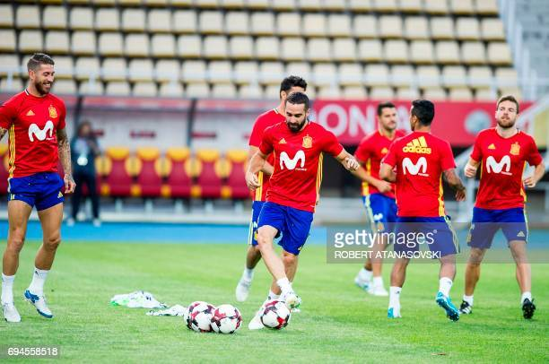 Spain's Dani Carvajal and Sergio Ramos take part in a training session in Skopje on June 10 on the eve of the FIFA World Cup 2018 qualification...