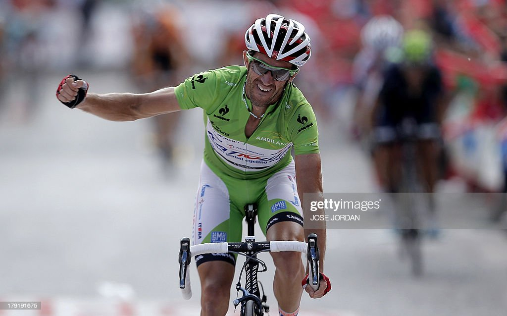 Spain's Dani Moreno (Katusha) celebrates winning as he crosses the finish line on September 1, 2013 after the nineth stage of the 68th edition of 'La Vuelta' Tour of Spain, a 163.7 km route between Antequera and Valdepenas de Jaen.