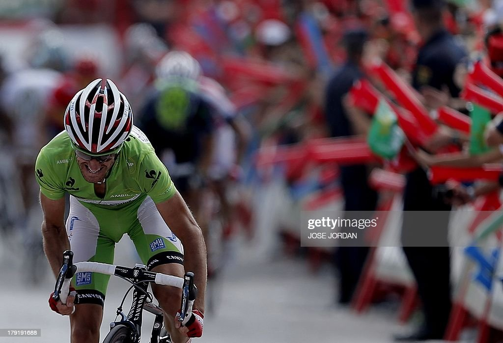 Spain's Dani Moreno (Katusha) crosses the finish line to win on September 1, 2013 after the nineth stage of the 68th edition of 'La Vuelta' Tour of Spain, a 163.7 km route between Antequera and Valdepenas de Jaen.