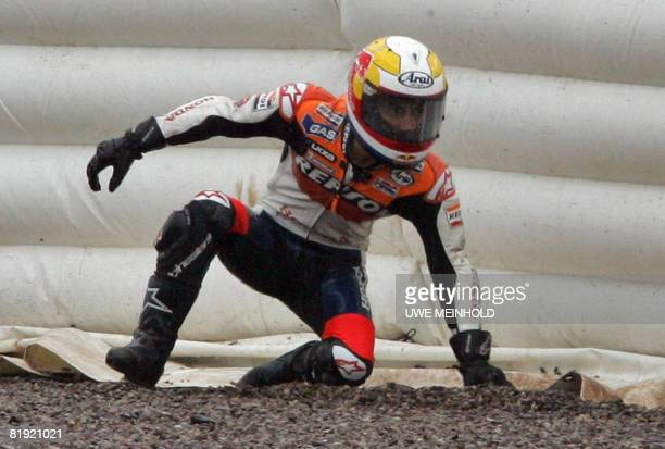 Spain's Dani Pedrosa gets up after crashing his bike during the 500cc race at the German Grand Prix meeting at the Sachsenring on July 13 2008 As a...