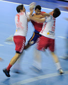 Spain's Daniel Sarmiento Melian vies with Serbians Nikola Manojlovic and Alem Toskic during the handball preOlympic qualifying match Spain vs Serbia...