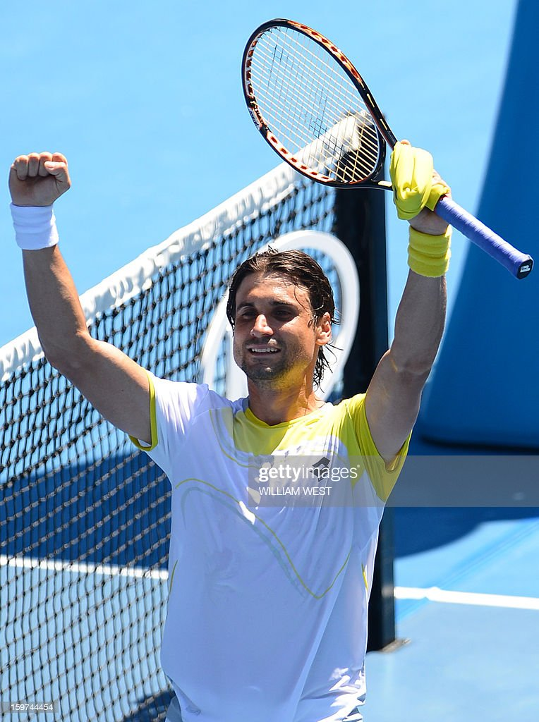 Spain's David Ferrer celebrates after victory in his men's singles match against Japan's Kei Nishikori on the seventh day of the Australian Open tennis tournament in Melbourne on January 20, 2013.