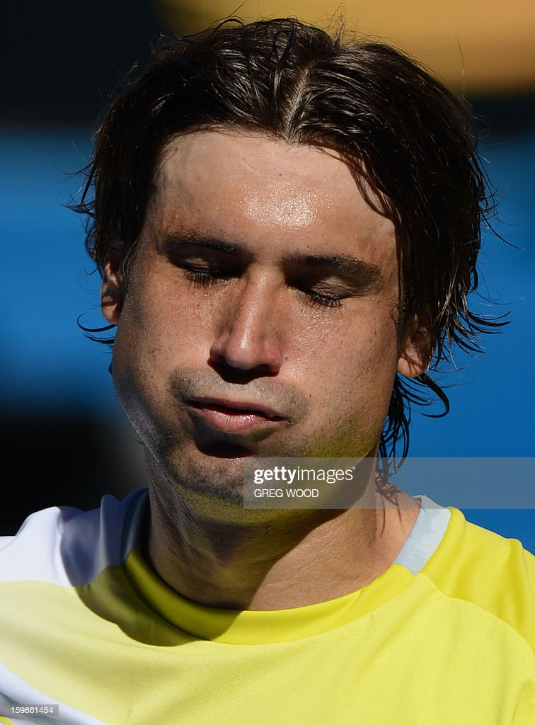 Spain's David Ferrer celebrates after victory in his men's singles match against compatriot Nicolas Almagro on the nineth day of the Australian Open tennis tournament in Melbourne on January 22, 2013.