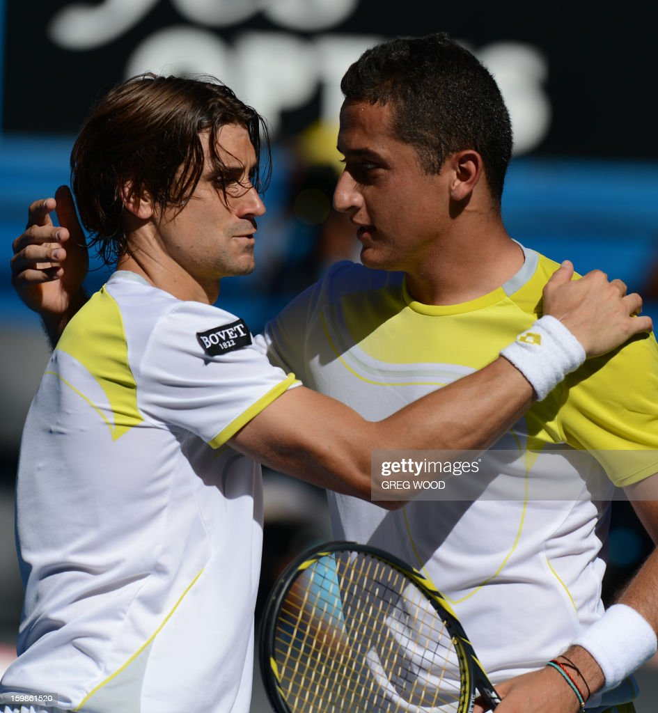 Spain's David Ferrer (L) embraces after victory in his men's singles match against compatriot Nicolas Almagro on the nineth day of the Australian Open tennis tournament in Melbourne on January 22, 2013.
