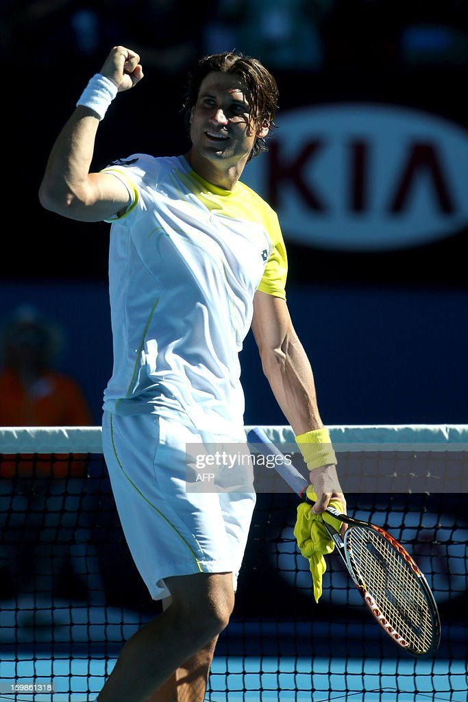 Spain's David Ferrer gestures as he celebrates after victory in his men's singles match against compatriot Nicolas Almagro on the nineth day of the Australian Open tennis tournament in Melbourne on January 22, 2013.