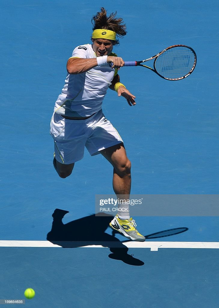 Spain's David Ferrer hits a return against Spain's Nicolas Almagro during their men's singles match on day nine of the Australian Open tennis tournament in Melbourne on January 22, 2013. AFP PHOTO / PAUL CROCK IMAGE STRICTLY RESTRICTED TO EDITORIAL USE - STRICTLY NO COMMERCIAL USE