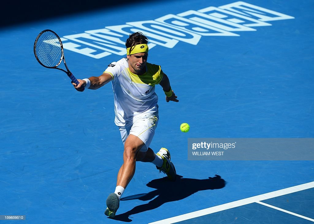 Spain's David Ferrer hits a return against Spain's Nicolas Almagro during their men's singles match on day nine of the Australian Open tennis tournament in Melbourne on January 22, 2013. AFP PHOTO / WILLIAM WEST IMAGE STRICTLY RESTRICTED TO EDITORIAL USE - STRICTLY NO COMMERCIAL USE