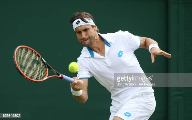 Spain's David Ferrer in action against Russia's Andrey Kuznetsov during day three of the Wimbledon Championships at the All England Lawn Tennis and...