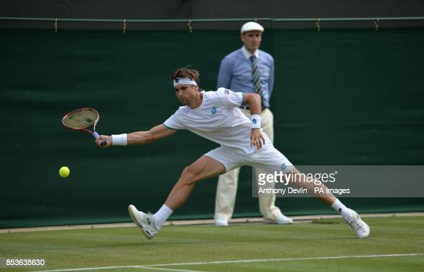 Spain's David Ferrer in action against Spoain's Pablo Carreno Busta during day one of the Wimbledon Championships at the All England Lawn Tennis and...