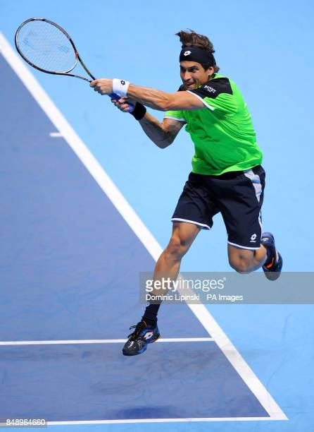 Spain's David Ferrer in action in his Men's Singles Group B match against Switzerland's Roger Federer during the Barclays ATP World Tour Finals at...