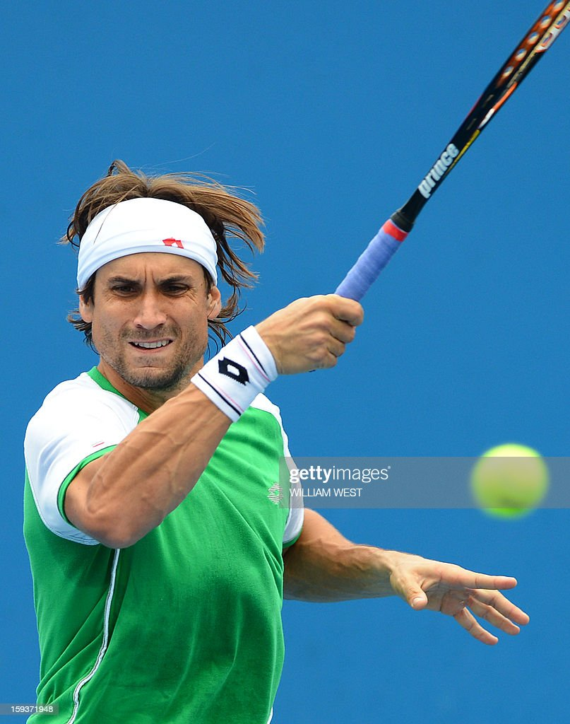 Spain's David Ferrer plays a return during a practice session ahead of the 2013 Australian Open tennis tournament in Melbourne on January 13, 2013.