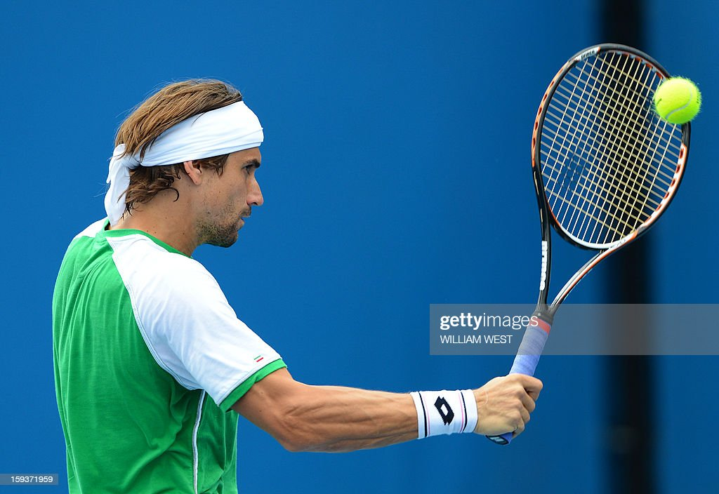 Spain's David Ferrer plays a return during a practice session ahead of the 2013 Australian Open tennis tournament in Melbourne on January 13, 2013. AFP PHOTO/WILLIAM WEST IMAGE STRICTLY RESTRICTED TO EDITORIAL USE - STRICTLY NO COMMERCIAL USE