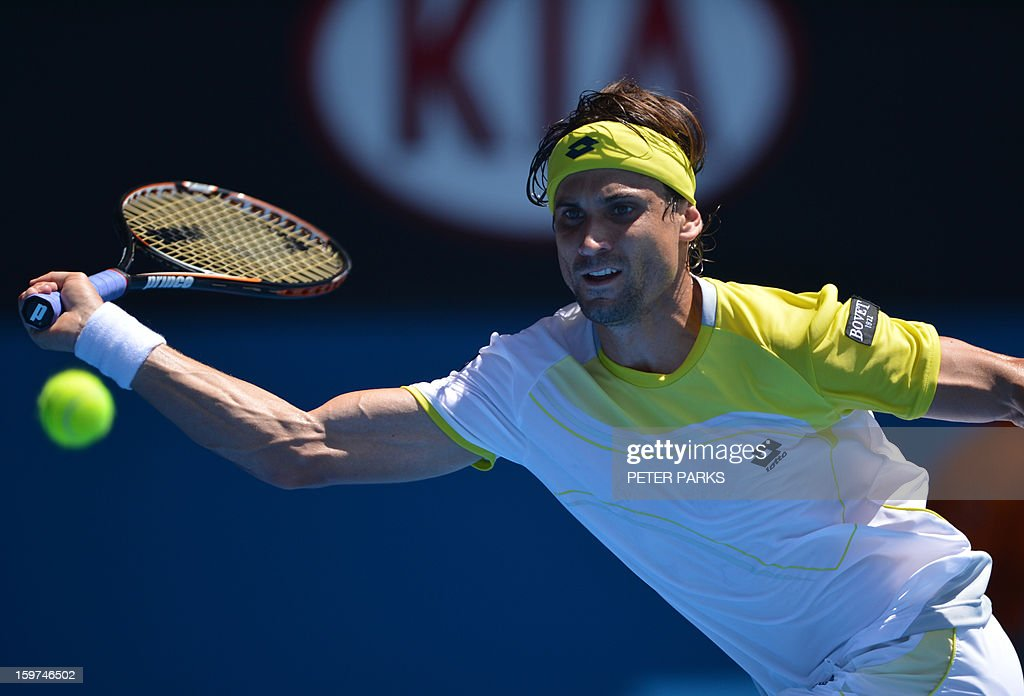 Spain's David Ferrer plays a return during his men's singles match against Japan's Kei Nishikori on the seventh day of the Australian Open tennis tournament in Melbourne on January 20, 2013.