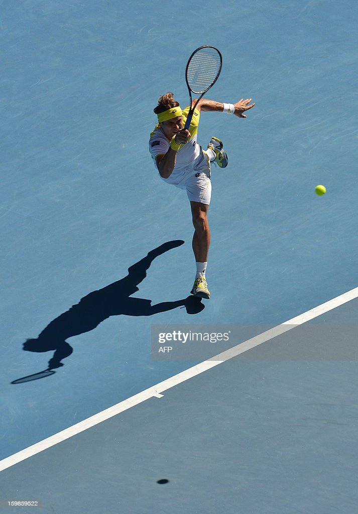Spain's David Ferrer plays a return during his men's singles match against compatriot Nicolas Almagro on the nineth day of the Australian Open tennis tournament in Melbourne on January 22, 2013. AFP PHOTO/PAUL CROCK IMAGE STRICTLY RESTRICTED TO EDITORIAL USE - STRICTLY NO COMMERCIAL USE