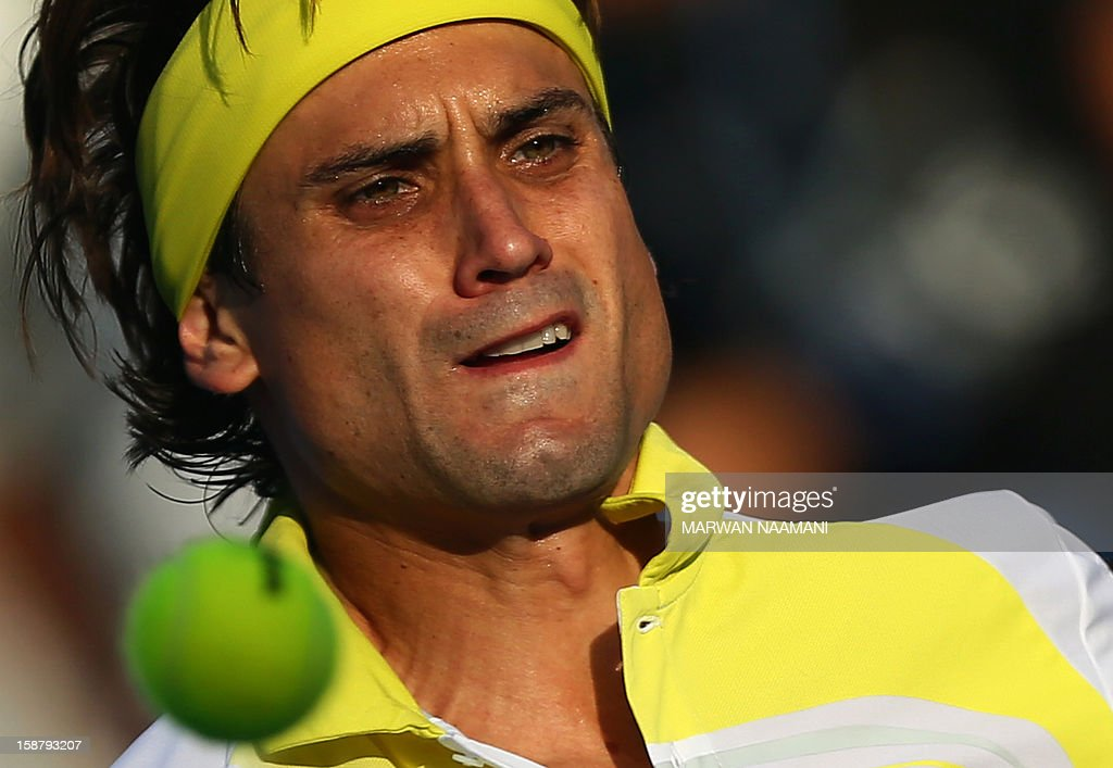 Spain's David Ferrer plays against Serbia's Janko Tipsarevic during their Mubadala World Tennis Championship play-off match for third place in the Emirati capital Abu Dhabi on December 29, 2012. AFP PHOTO/MARWAN NAAMANI