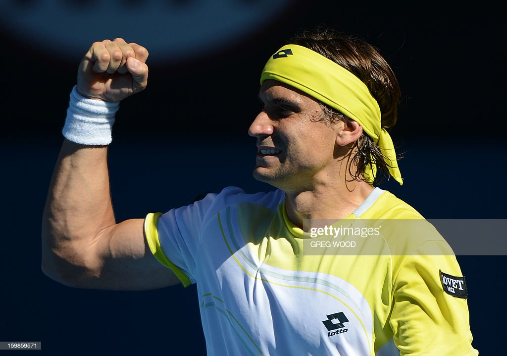 Spain's David Ferrer reacts after a point against Spain's Nicolas Almagro during their men's singles match on day nine of the Australian Open tennis tournament in Melbourne on January 22, 2013.