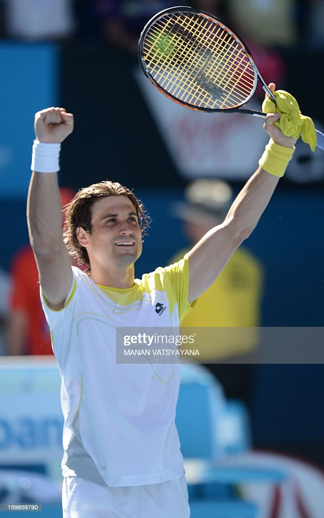 Spain's David Ferrer reacts after victory in his men's singles match against compatriot Nicolas Almagro on the nineth day of the Australian Open tennis tournament in Melbourne on January 22, 2013.