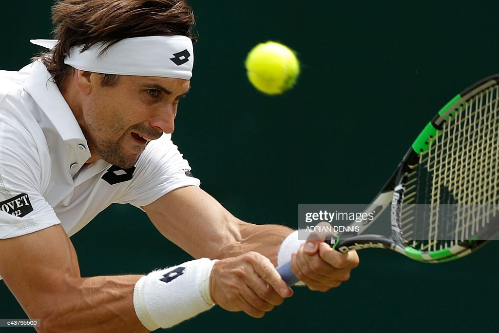 Spain's David Ferrer returns against France's Nicolas Mahut during their men's singles second round match on the fourth day of the 2016 Wimbledon Championships at The All England Lawn Tennis Club in Wimbledon, southwest London, on June 30, 2016. / AFP / ADRIAN