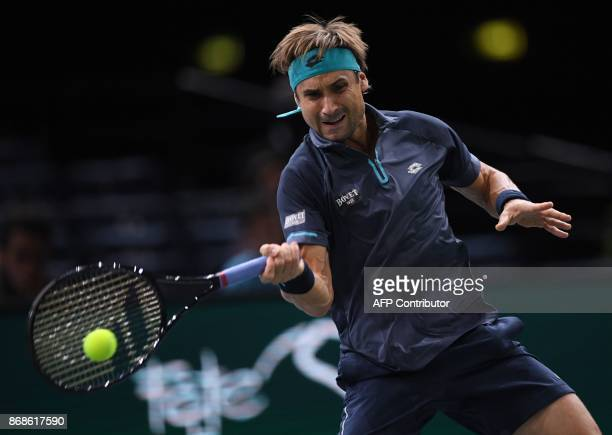 Spain's David Ferrer returns the ball to France's Adrian Mannarino during their first round match at the ATP World Tour Masters 1000 indoor tennis...
