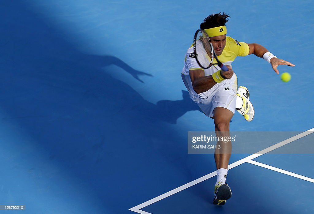 Spain's David Ferrer returns the ball to Serbia's Janko Tipsarevic during their Mubadala World Tennis Championship play-off match for third place in the Emirati capital Abu Dhabi on December 29, 2012.