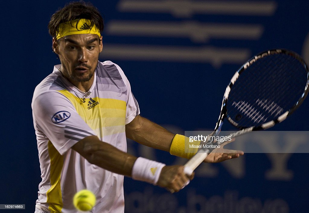 Spain´s <a gi-track='captionPersonalityLinkClicked' href=/galleries/search?phrase=David+Ferrer&family=editorial&specificpeople=208197 ng-click='$event.stopPropagation()'>David Ferrer</a> serves the ball to Italy´s Fabio Fognini during the Acapulco Tennis Open in the Pacific resort in Acapulco, Monday, March 1, 2013
