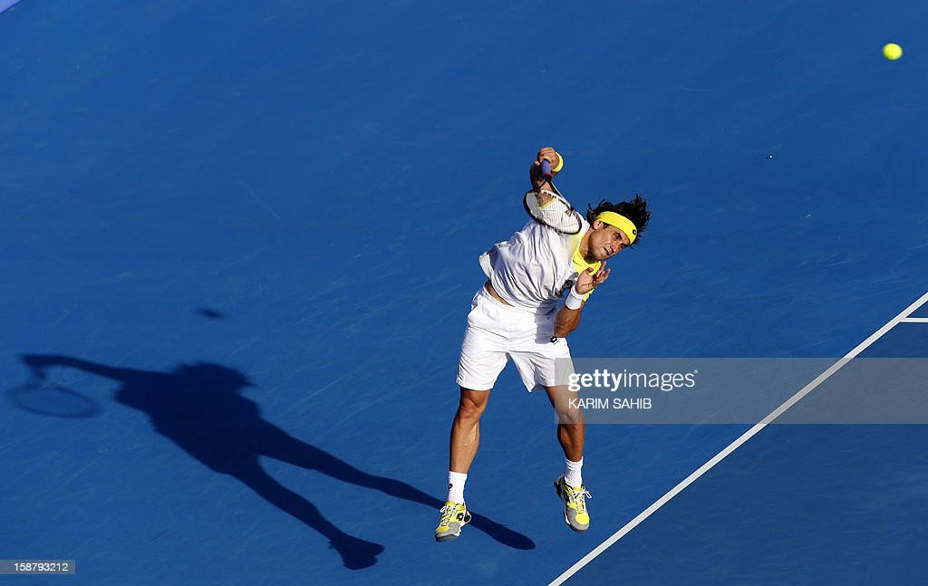 Spain's David Ferrer serves to Serbia's Janko Tipsarevic during their Mubadala World Tennis Championship play-off match for third place in the Emirati capital Abu Dhabi on December 29, 2012. AFP PHOTO/KARIM SAHIB