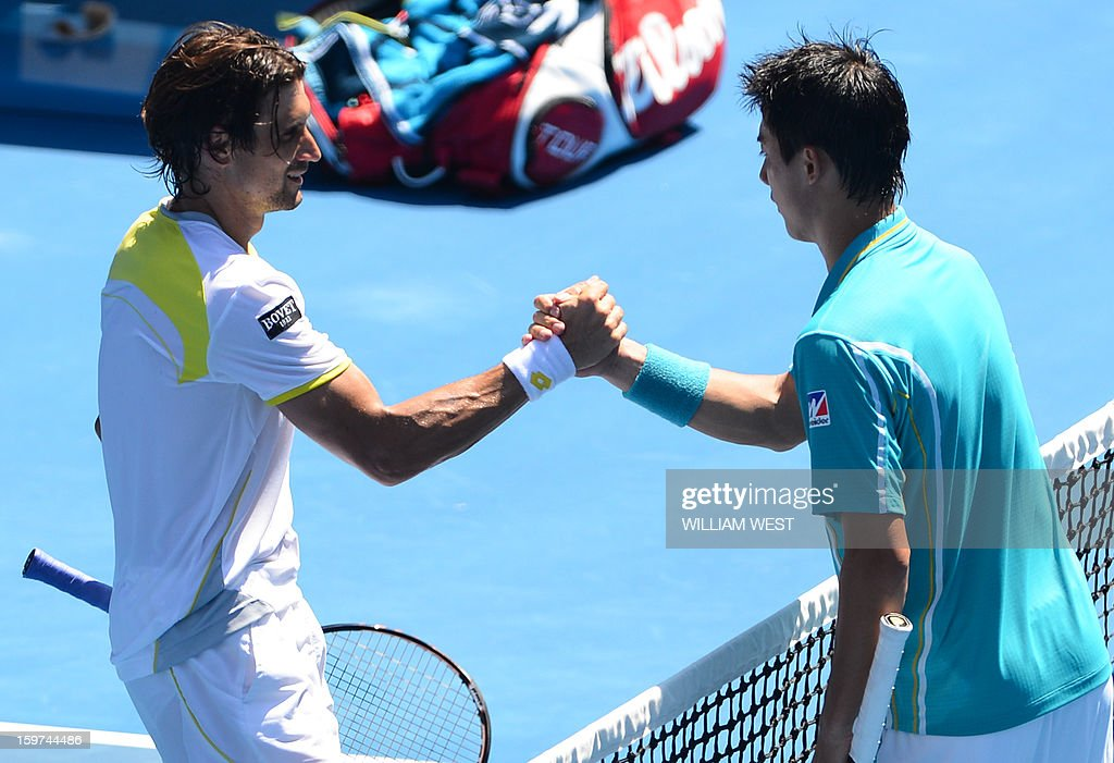 Spain's David Ferrer (L) shakes hands after victory in his men's singles match against Japan's Kei Nishikori on the seventh day of the Australian Open tennis tournament in Melbourne on January 20, 2013.