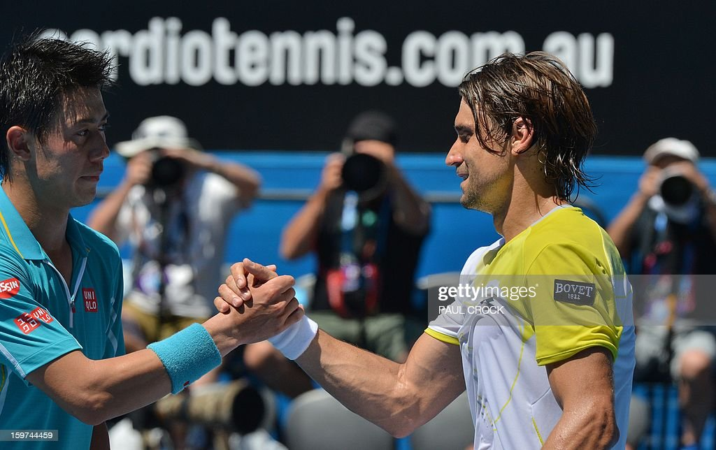Spain's David Ferrer (R) shakes hands with Japan's Kei Nishikori after his victory during their men's singles match on day seven of the Australian Open tennis tournament in Melbourne on January 20, 2013.