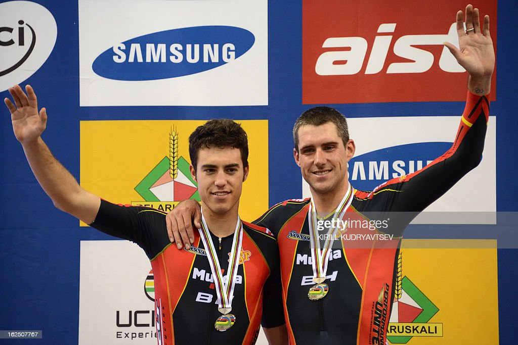 Spain's David Muntaner Juaneda and Albert Torres Barcelo celebrate with their silver medal on the winners podium of the UCI Track Cycling World Championships Men's 50 km Madison in Belarus' capital of Minsk on February 24, 2013. AFP PHOTO/KIRILL KUDRYAVTSEV