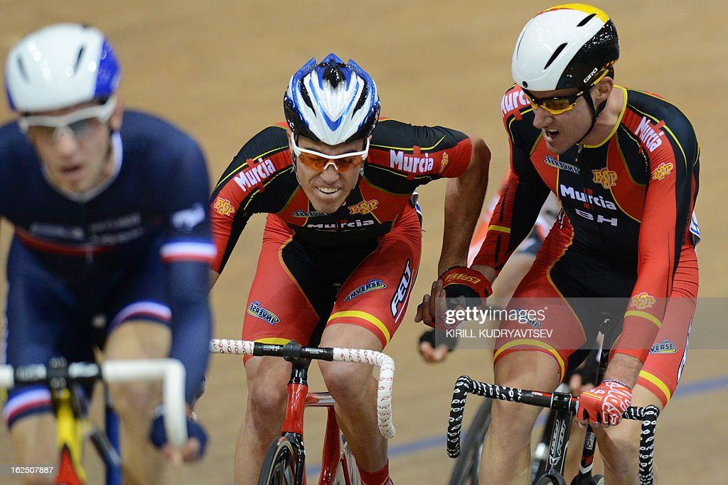 Spain's David Muntaner Juaneda and Albert Torres Barcelo compete to win the silver medal in UCI Track Cycling World Championships Men's 50 km Madison in Minsk on February 24, 2013. AFP PHOTO/KIRILL KUDRYAVTSEV