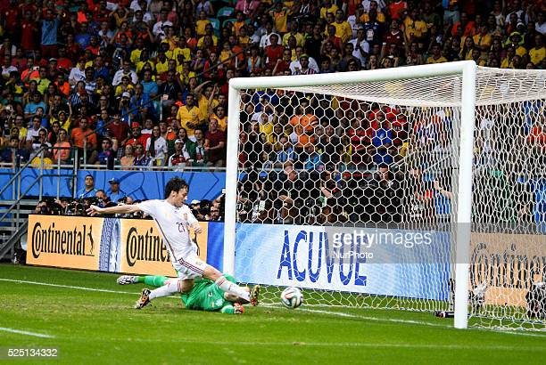 Spain's David Silva scores a nonvalid goal at the 2014 World Cup match between Spain and Netherlands in Salvador Brasil this friday 13th