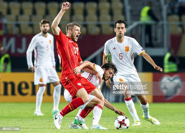 Spain's David Silva vies with Macedonia's Stefan Ristovski during the FIFA World Cup 2018 qualification football match between Macedonia and Spain at...
