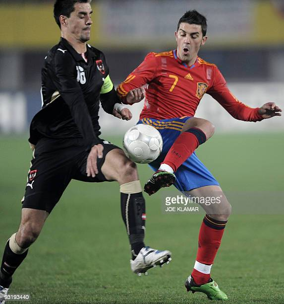 Spain's David Villa fights for a ball with Austria's captain Paul Scharner during their friendly football match between Austrian and Spain at Ernst...