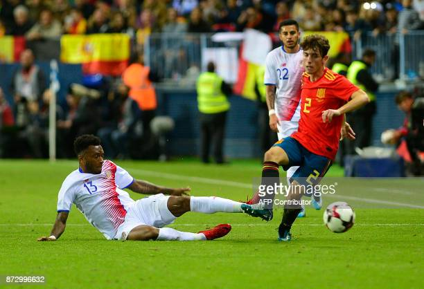 Spain's defender Alvaro Odriozola vies for the ball with Costa Rica's defender Kenner Gutierrez during the international friendly football match...