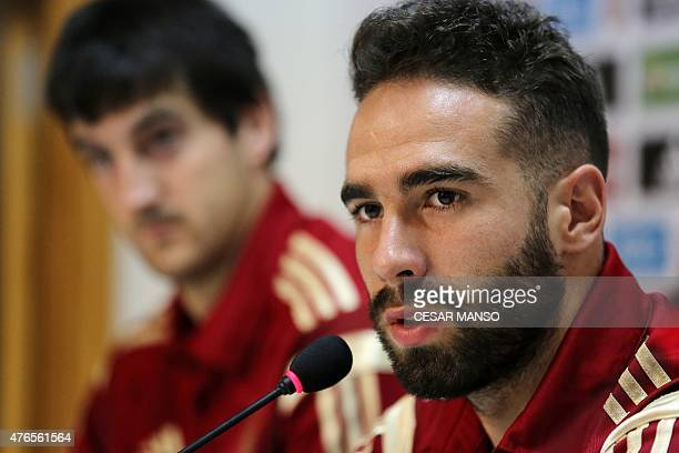 Spain's defender Dani Carvajal and Spain's defender Mikel San Jose give a press conference at the Reino de Leon stadium in Leon on June 10 on the eve...